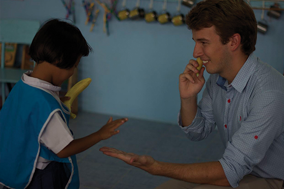 Liam congratulating one of his kindergarten pupils when teaching English in Thailand in 2012