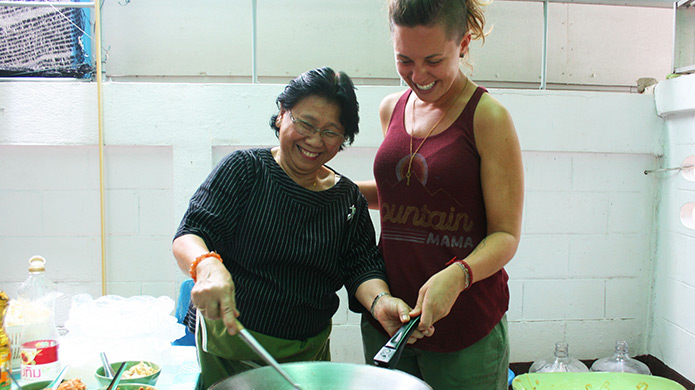 Learn how to cook traditional Thai food as part of your orientation in Thailand.