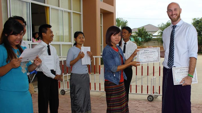 Students in Myanmar with their certificates